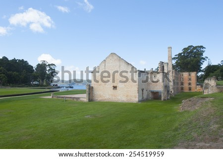World Heritage Site of  Port Arthur Convict Museum Settlement in Tasmania, Australia, with ruins of historic prison and other buildings and harbour in background - stock photo