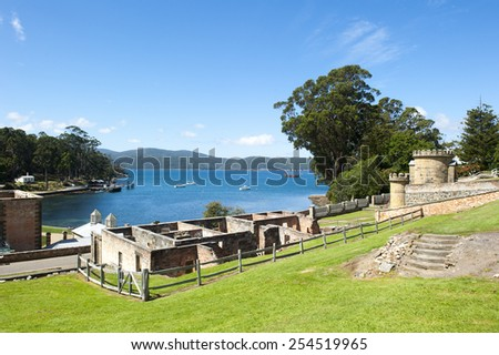 World Heritage Site of  Port Arthur Convict Museum Settlement in Tasmania, Australia, with ruins of historic buildings, tourist attraction, scenic view over harbour. - stock photo