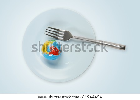 World in a plate with fork - stock photo