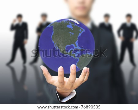 World in businessman hand