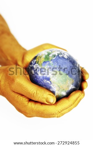 World in gold painted hands Some components of this montage are provided courtesy of NASA - stock photo