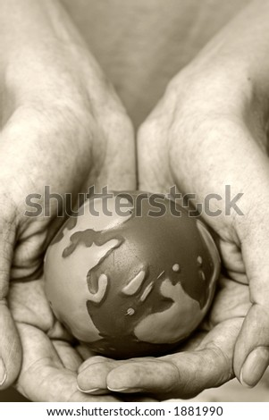 World in our hands in sepia - stock photo