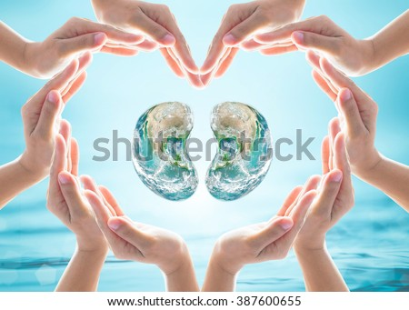 World Kidney Day design logo concept idea: Love heart shape symbolic sign of women human hands on blur blue turquoise clean aqua water background: Element of this image furnished by NASA - stock photo