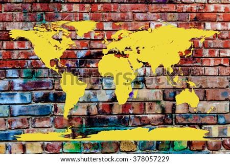 World Map embossed on Graffiti laden brick wall - stock photo