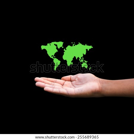 world map green shape floating on hand - stock photo