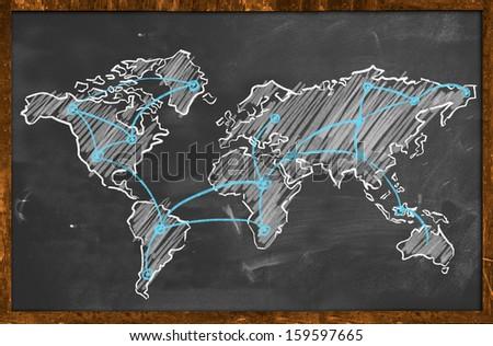 World map network drawing on blackboard - stock photo