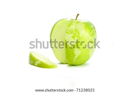 World map on a fresh green apple with a slice cut out. - stock photo