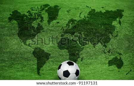 world map on a green lawn - stock photo