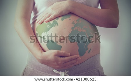 world map on a pregnant woman's belly