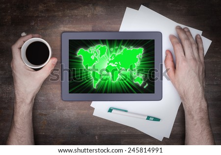 World map on a tablet, concept of globalisation - stock photo