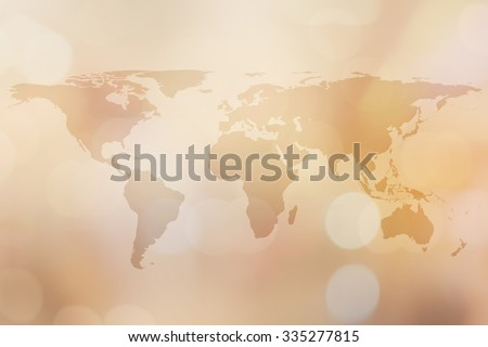 World map on golden blurred backgrounds with bokeh.blurred shiny gold colored backgrounds:blurry shining gold colour map of earth wallpaper backdrop:blurred backgrounds concept.cream tone styles. - stock photo