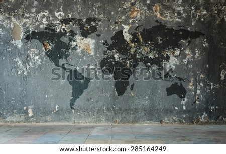 World map on old wall. - stock photo