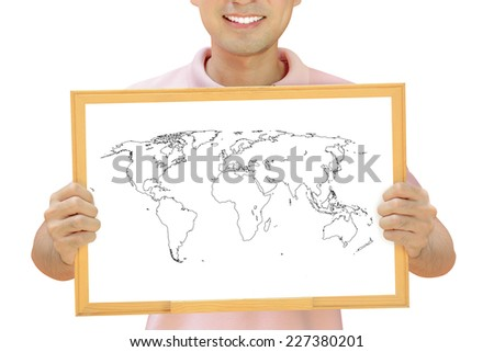 World map outline on whiteboard held by smiling man - stock photo