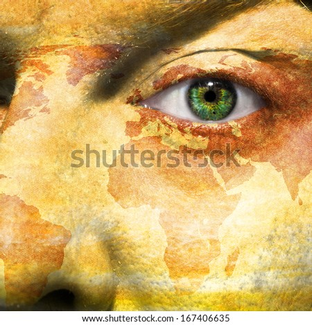 World map overlay on a man's face with a green eye - stock photo