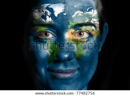 World map painted on beauty woman face - stock photo