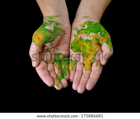 World map painted on hands.