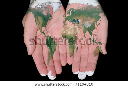 World Map Painted On Hands Showing Concept Of The World In Our Hands - stock photo