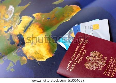 World map, polish passport and credit cards - stock photo