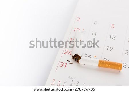World No Tobacco Day : Broken cigarette  on calendar - stock photo