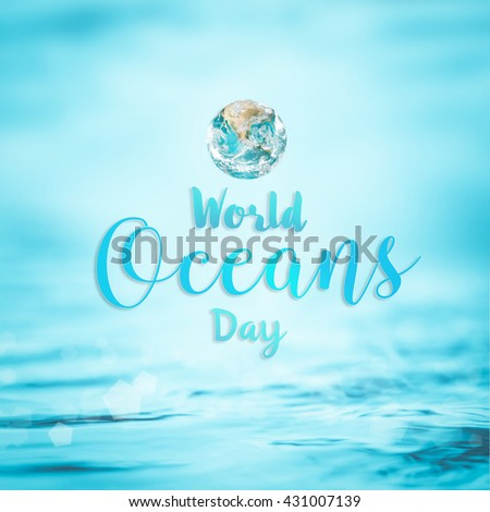 World ocean day June 8 beautiful text message environment CSR campaign with green turquoise save eco mother earth planet on blur clean water nature bokeh background: Element of image furnished by NASA - stock photo