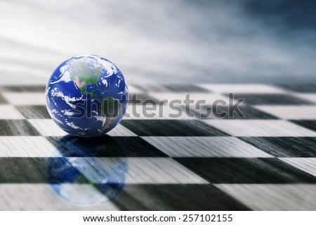 world on a chessboard isolated on blue sky background. Elements of this image furnished by NASA - stock photo