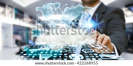 World over a cloud with connections and modern icons in businessman hand