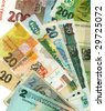 World paper currencies background. Enjoy solitaire. - stock photo