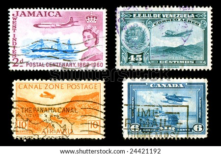 World postage stamps with airplanes cancelled isolated on black