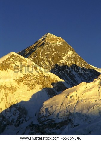 World's highest mountain, Mt Everest (8850m) and Nuptse to the right in the Himalaya, Nepal. - stock photo