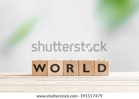 World sign made of cubes on a wooden table - stock photo