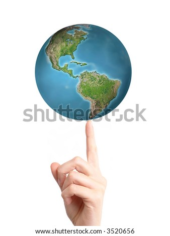 World spinning on index fingertip over white background - stock photo