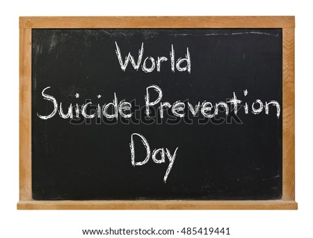 World Suicide Prevention Day written in white chalk on a black chalkboard isolated on white