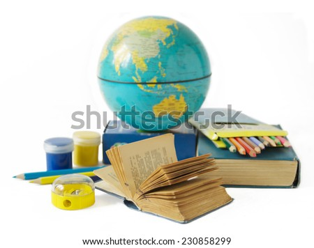 World Teacher's Day (still life with book pile, globe and colorful pencil on white background) - stock photo