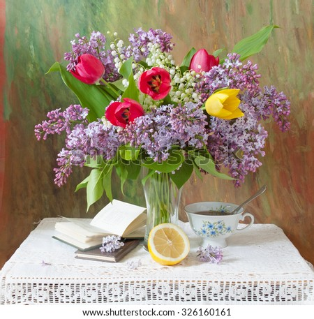 World Teacher's Day (still life with tulips and lilac bunch and books on artistic background) - stock photo