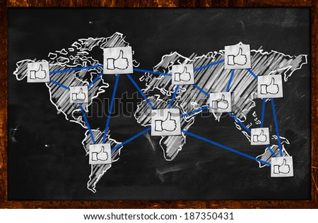 World thumb up Connection on Blackboard - stock photo