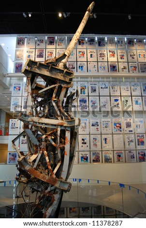World Trade Center antenna and front pages of 9/11 newspapers in Newseum, Washington DC - stock photo