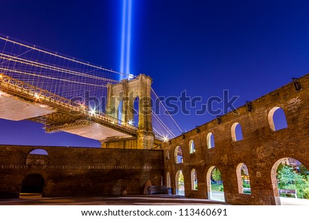 World Trade Center Lights over Brooklyn Bridge at night - beautiful HDR colors in New York City from gritty outdoor space - stock photo