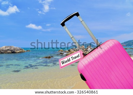 World Travel word, Suitcase with label  - stock photo
