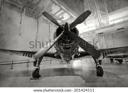 World War II era fighter plane in a hangar