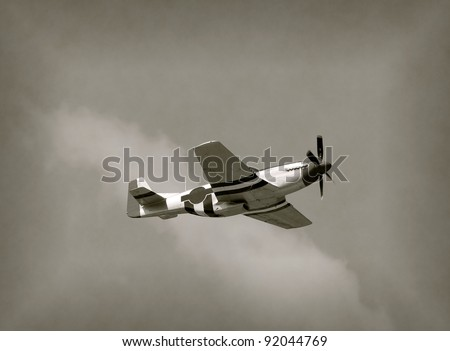 World War II era fighter plane in flight - stock photo