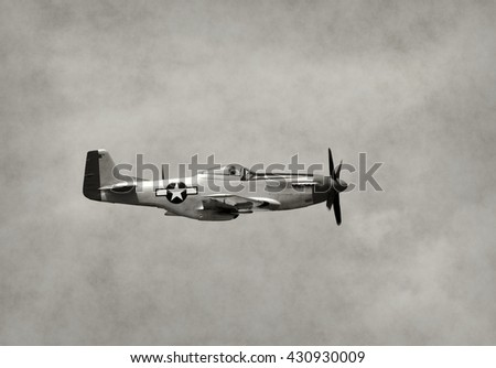 World War II era fighter plane in flight side view - stock photo
