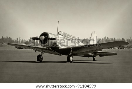 World War II era propeller airplane, faded black and white - stock photo