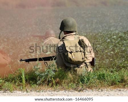 World War II era soldier in a cross fire - stock photo