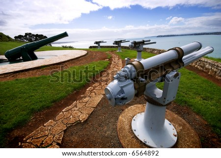 World War II guns pointing out to sea - stock photo