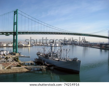 World War II Ship docked in a harbor - stock photo