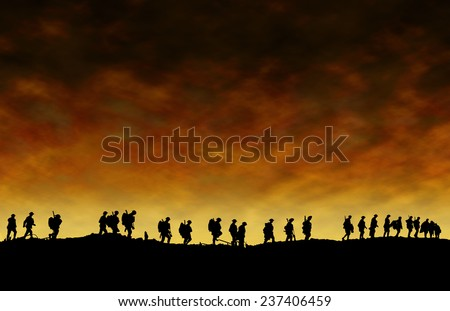 World War One Soldiers Silhouettes Below Cloudy Skyline At Dusk or Dawn - stock photo
