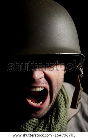 World War Two American soldier shouting out orders. - stock photo
