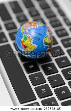 World wide web concept with globe on laptop.