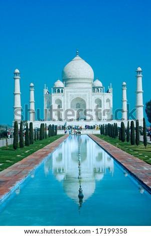 World wonder Taj Mahal in soft daily light with blue sky - stock photo