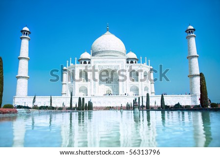World wonder Taj Mahal in soft daily light with clear blue sky - stock photo